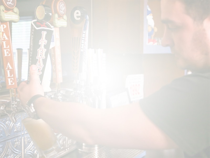 Bartender pouring beer from a tap